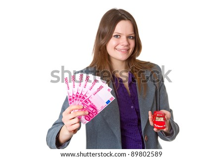 Young friendly businesswoman with model car - isolated on white background - stock photo