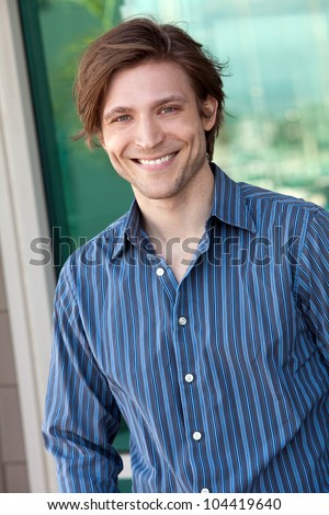 Young friendly casual man smiling