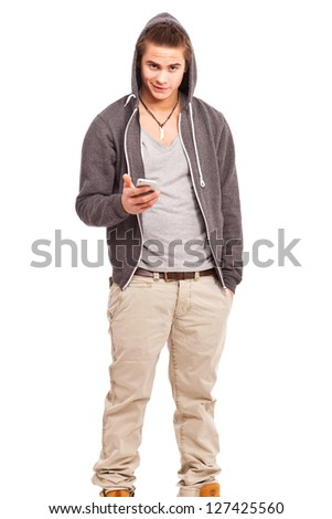 young, friendly guy holding his cellphone - stock photo