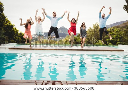 Young friends and jumping in the swimming pool - stock photo