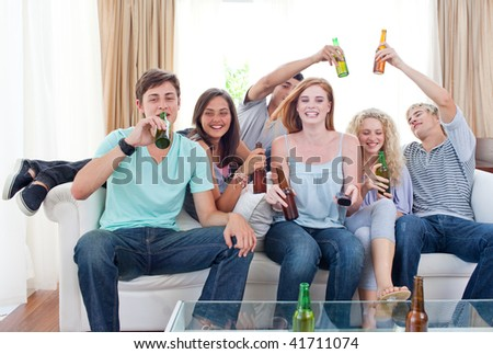 Young friends drinking beer at home