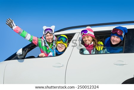 young friends   go to winter vacations in car - stock photo