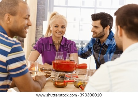 Young friends having dinner party together, smiling, having fun. - stock photo