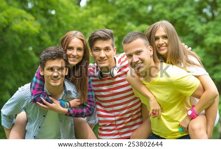 Young friends having fun outdoor - stock photo
