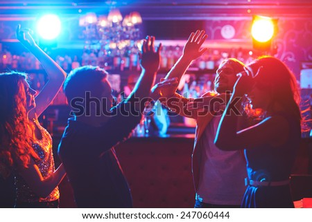 Young friends having great party with dancing - stock photo