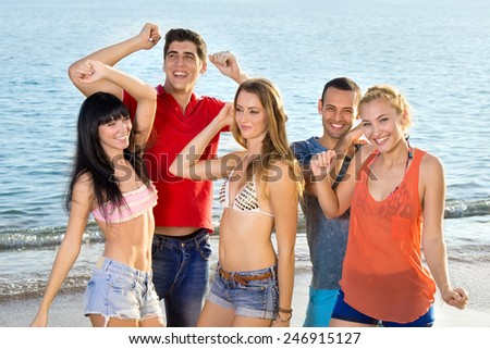Young Friends in Summer Outfits Enjoying at the Beach on During Summer Season.