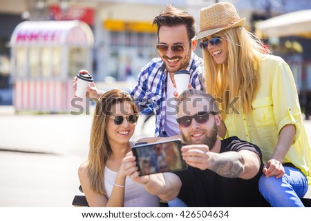 Young friends making selfie outdoors while enjoying together - stock photo