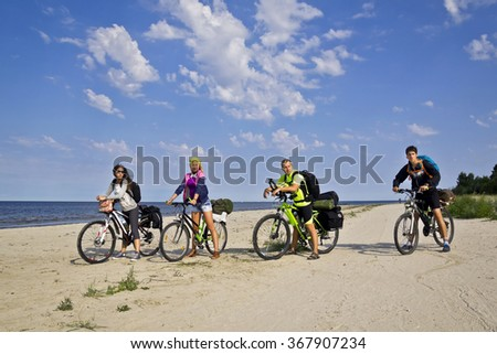 young friends on bike tour around baltic sea - stock photo