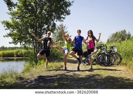 young friends on bike touring  - stock photo