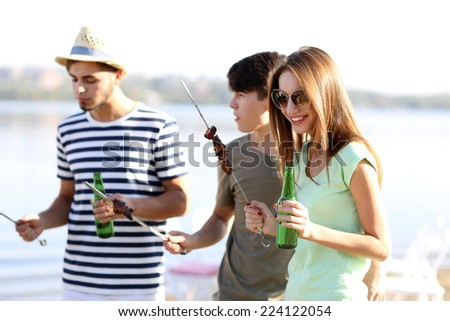 Young friends on rest, outdoors - stock photo