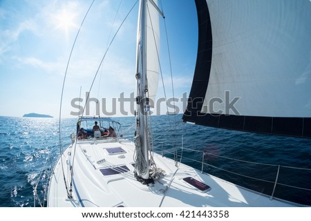 Young friends sailing in a blue sea on the yacht - stock photo