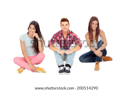 Young friends sitting on the floor isolated on white - stock photo