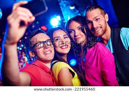 Young friends taking selfie - stock photo