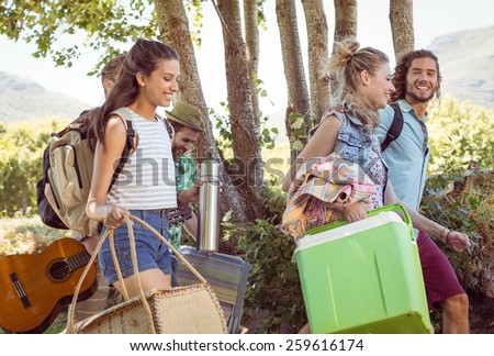Young friends walking towards their campsite at a music festival - stock photo