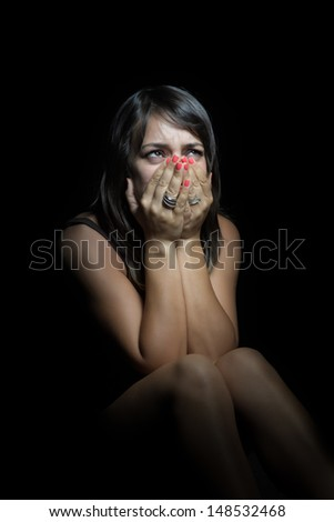 Young frightened adult woman with lonely hopeless gesture - stock photo