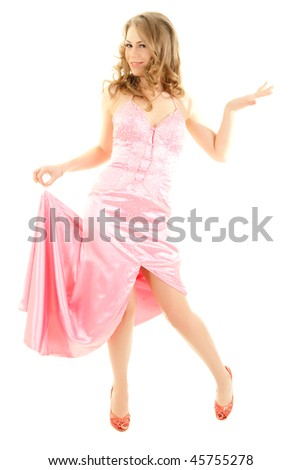 Young frivolous woman in pink evening dress
