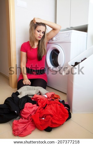 Young frustrated woman by washing in the bathroom