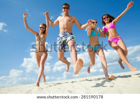 Young fun people enjoying summer on the beach - stock photo