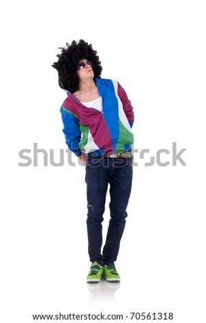 young funky man looking up with his hand in the back - stock photo