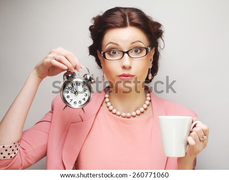 Young funny businesswoman having a coffee-break - stock photo