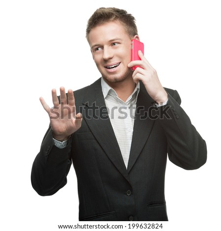 young funny caucasian businessman in black suit talking at pink cell phone isolated on white - stock photo