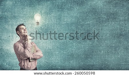 Young funny man and light bulb. Idea concept - stock photo