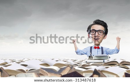 Young funny man in glasses with big head among pile of old books