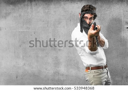 young funny man with machine gun
