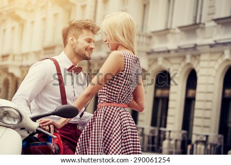 Young funny pretty fashion vintage hipster couple having fun outdoor on the street in summer.  - stock photo