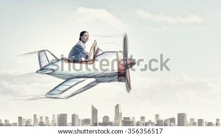 Young funny woman flying in air in drawn airplane