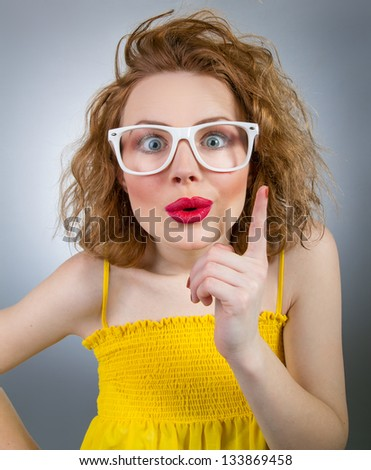 Young funny woman have idea, clever girl - stock photo