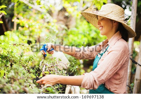 young gardener with bonsai - stock photo
