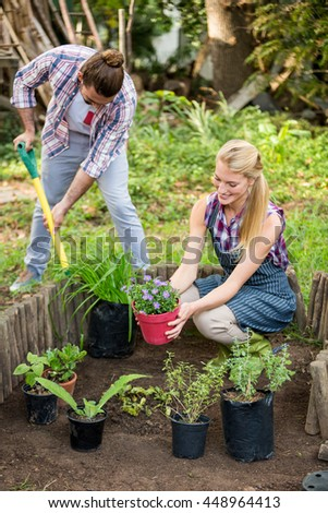 Young gardeners planting at botanical garden