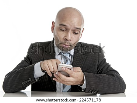 young geek businessman using compulsively cell phone in social network , mobile and internet addiction concept looking dumb and freak isolated on white background - stock photo