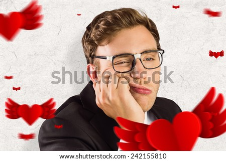 Young geeky businessman looking bored against parchment - stock photo