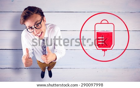 Young geeky businessman showing thumbs up against painted blue wooden planks - stock photo