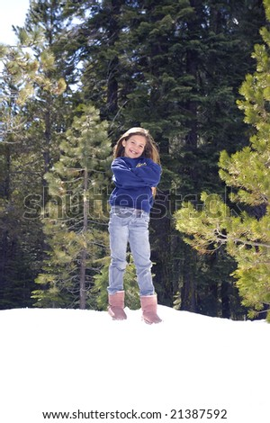 Young girl acting silly in the snow - stock photo