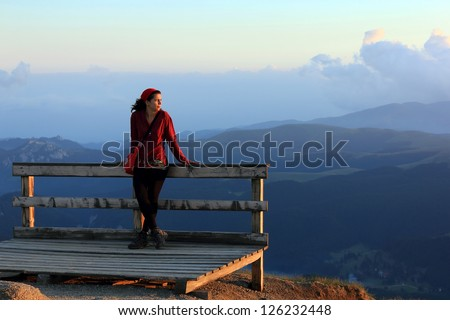 Young girl admireing the alpine landscape - stock photo