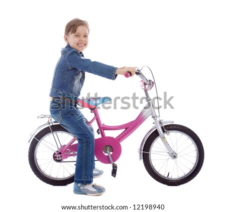 Young girl ages 5-7 years old isolated on white sitting on her bike - stock photo