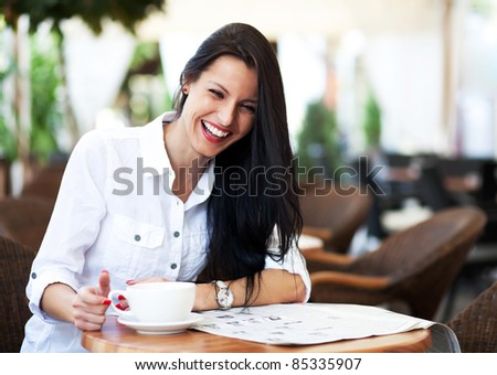 Young girl amused by the news - stock photo