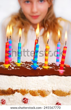 young girl and birthday cake with burning candles
