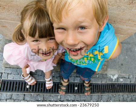 Young girl and boy loking up - stock photo