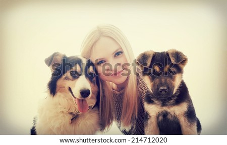 young girl and dogs - stock photo