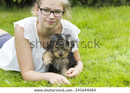 young girl and her dog - stock photo