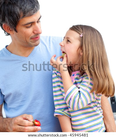 Young girl and her father having breakfast in the kitchen