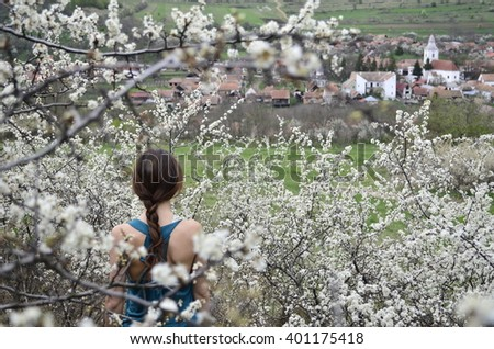 Young girl and the cherry blossom. - stock photo