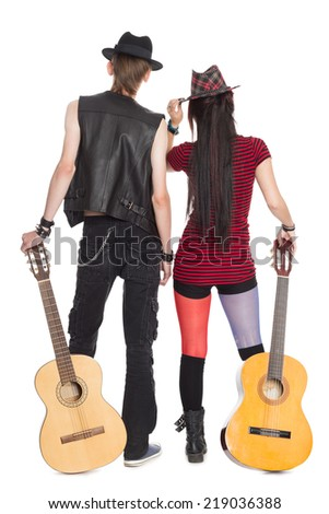 Young girl and the guy with the guitars, rear view.  - stock photo