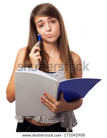 young girl annoyed holding a notebook isolated on white - stock photo