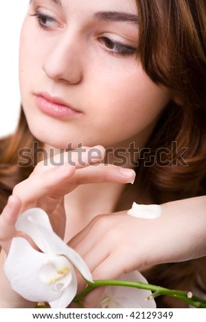 Young girl apply hand cream, soft focus