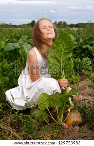 Young girl at country plants